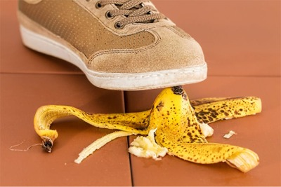 shoe starting to step on a banana peel